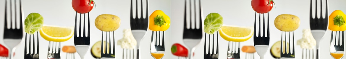 Forks with vegetables on the end of them